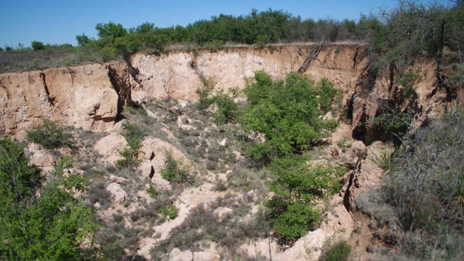 This sharp dropoff from the level plain into the canyon below was a perfect location for native Americans to drive bison over the cliff.