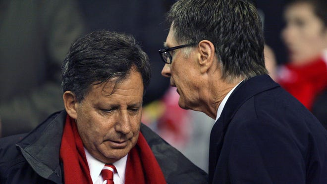 Liverpool owners John Henry, right, and Tom Werner, shown here at an English League Cup semifinal second-leg soccer match, watched their team clinch the Premier League title on television from the U.S.