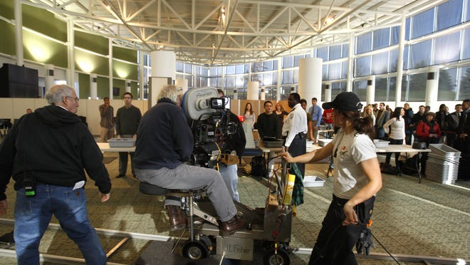 In this Dec. 1, 2009  file photo, a movie is filmed on set in Ann Arbor, Mich. Those for and against incentives for the film industry have much to say about those launched in 2008 and ended in 2015.
