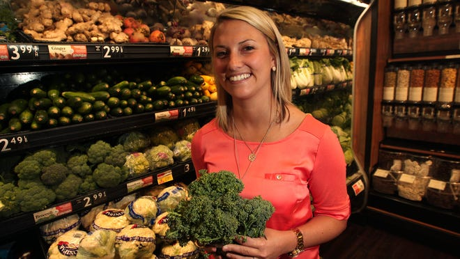Amanda Fischer, director of business relations for Village Super Market, shows broccolini, just one of the hybrid produce at ShopRite of Greater Morristown.<252>