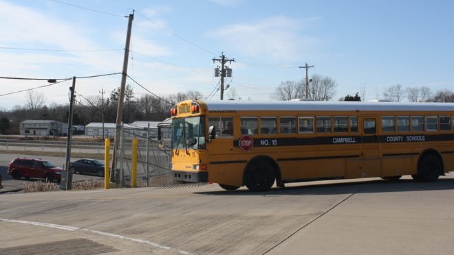 A bus turns into a bus garage for Campbell County Schools from U.S. 27.