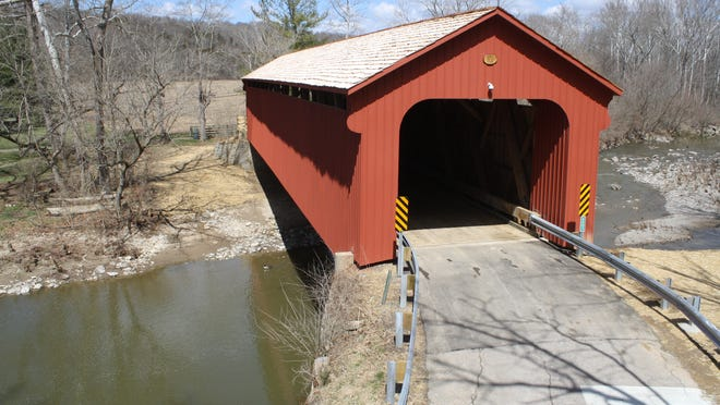 The Stonelick-Williams Corner Covered Bridge in Clermont County, now reopened, was damaged when an overweight truck attempted to cross.