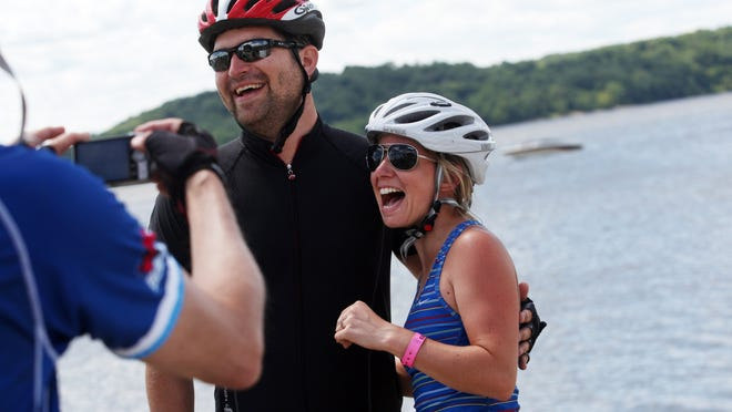 """Jenny Neugent and Erik Miller got engaged July 27, 2013, in Fort Madison after dipping their tires in the Mississippi upon the completion of RAGBRAI. """"We made a pact that we'd do RAGBRAI every year from then on,"""" Neugent said. The couple will marry next month."""