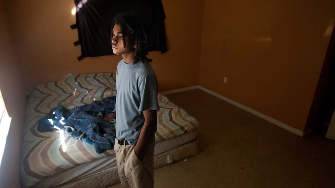 """Derick Simpson, 15, brother of Andrew Faust Jr., returned Thursday to the room where Andrew was killed in a shooting in Fort Myers. """"I keep expecting to see him again, but I know I he's not coming back. He's gone,"""" said Simpson."""