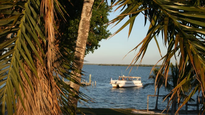 A boat approaches the dock at Useppa Island. The holidays are a perfect time to rediscover Southwest Florida.