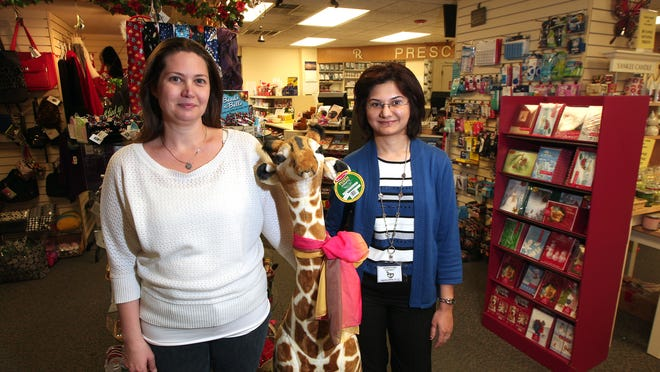 Manager Linda Molnar, l, and Head Pharmacist Isha Bodalia at the Morris Plains Pharmacy on Speedwell Avenue.