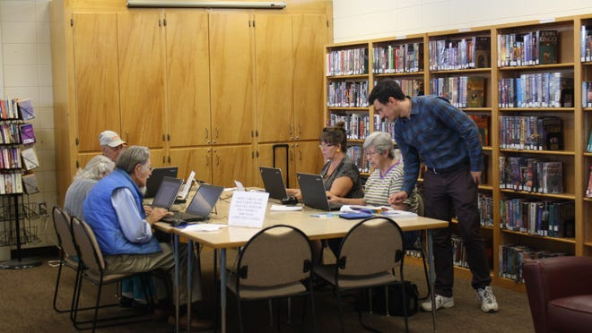 Greg Cooper (standing) with Connect Arkansas, a project of The Arkansas Capital Corporation Group, leads a recent computer class at Marion County Library. The class covered basic computer skills, using an e-reader and a Power Point presentation.
