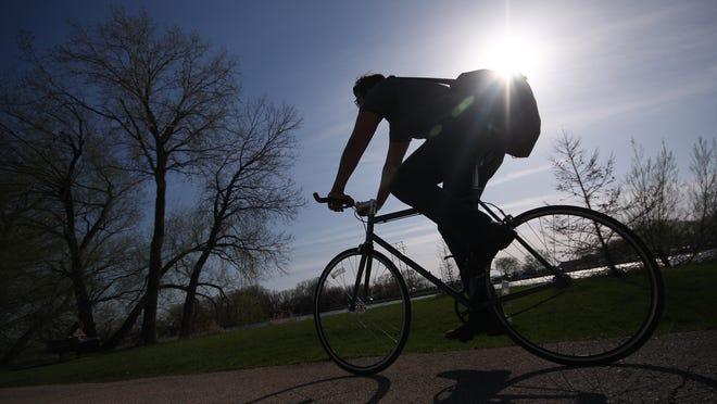 A cyclist enjoys a ride on the Wiouwash Trail in Oshkosh.