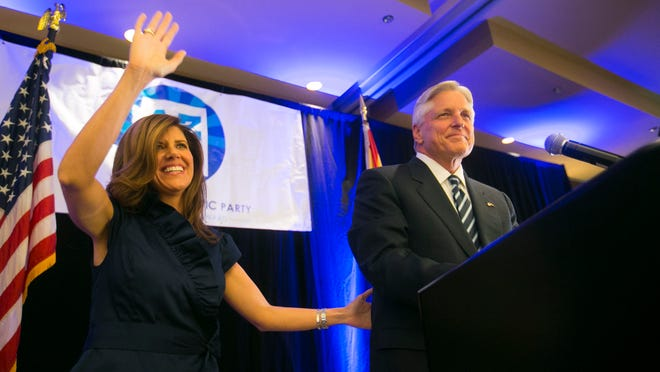 Fred Duval, the Democratic candidate for governor, concedes on Nov. 4 with his wife, Jennifer. The Democrats were swept in the statewide races for the second straight election cycle.