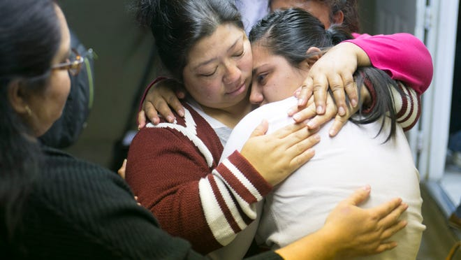 Maria Gomez (left) hugs her daughter Noemi Romero during a gathering Thursday to watch the president's speech on his plans for executive action on immigration reform.