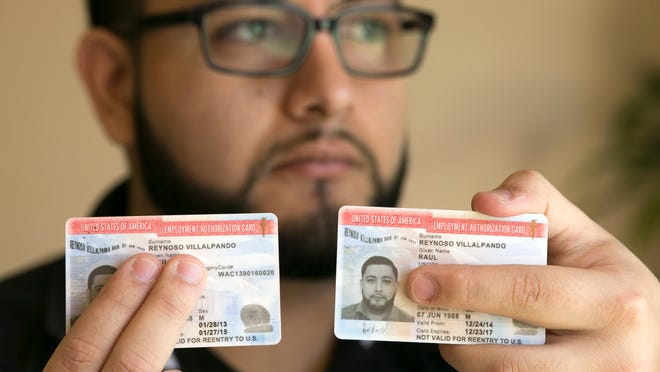 """Raul Reynoso, a 26-year-old """"dreamer"""" from Mexico, was surprised to receive a three-year renewal of his federal work permit (right). His previous permit (left) was for two years."""