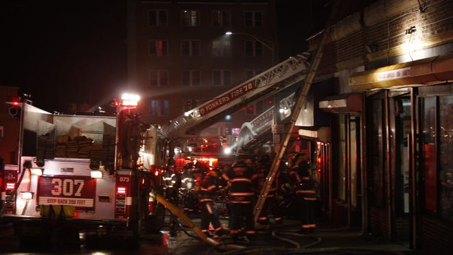 Firefighters respond to blaze at 5 Caryl Ave. on March 12, 2014.
