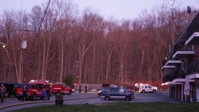 Firefighters respond to a brush fire off of Rome Avenue in Bedford Hills on April 19, 2014.