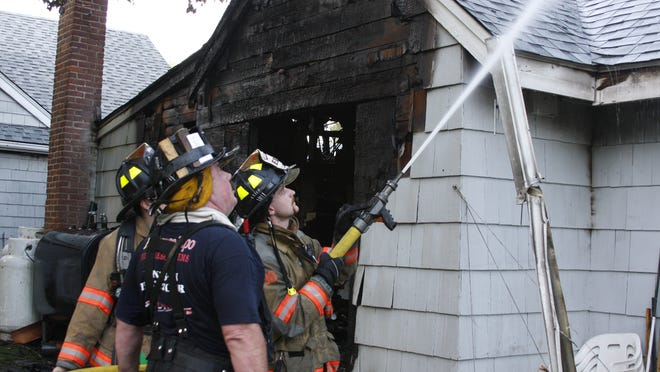 Firefighters extinguish fire at 228 Smith Ridge Road in the Vista hamlet of Lewisboro on June 19, 2014.