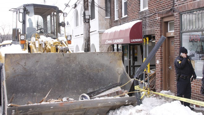 A bucket loader struck the entryway of an apartment building at 36 and 38 Marble Ave., causing structural damage and displacing 20 people Tuesday.