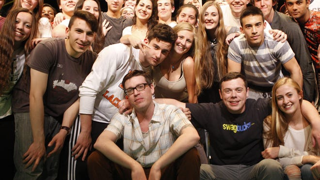 """Former Horace Greeley High School teacher Christopher Schraufnagel with students before a 2015 production of """"Hair."""""""