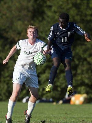 Burlington's Seraphin Iradukunda (11) battles for the ball with Rice's Hugh Sheahan (17) during a high school boys soccer game earlier this season.