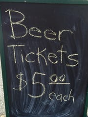 A beer sign sitting just inside the entrance of the Shenandoah Valley Blues and Brews Festival.