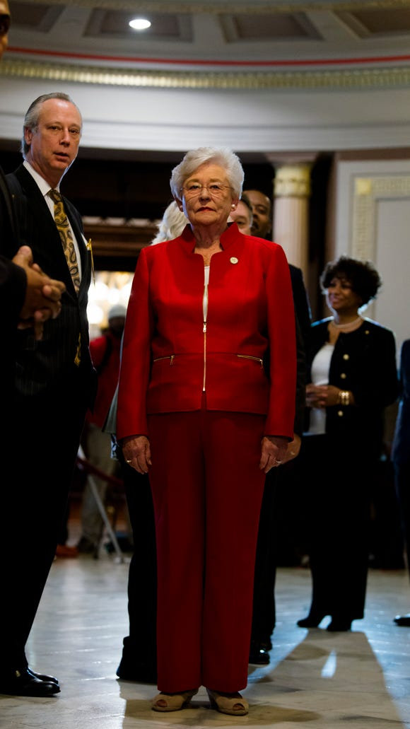 Governor Kay Ivey walks into the Old House Chamber to give the Alabama State of the State address on Tuesday, Jan. 9, 2018, at the Alabama Capitol building in Montgomery, Ala.