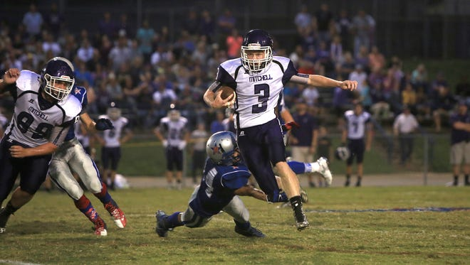 Peyton Greene helped Mitchell pile up 525 team rushing yards Friday at McDowell.