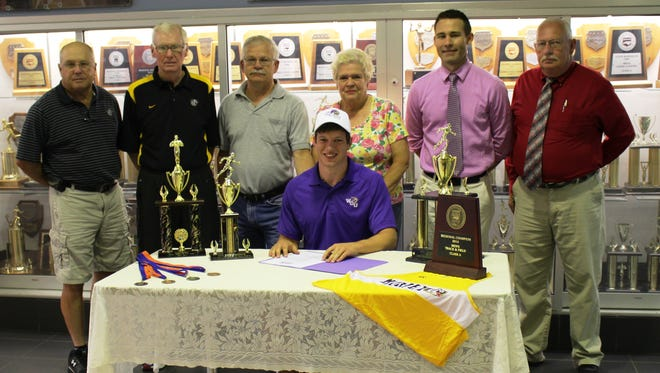 Caesar Campana, second from right in the back row, recently took part in a signing ceremony for Bulldogs track athlete Robbie Tompa.