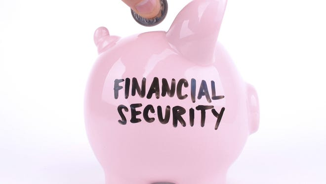 Photo illustration shows a piggy bank for saving toward retirement financial security.