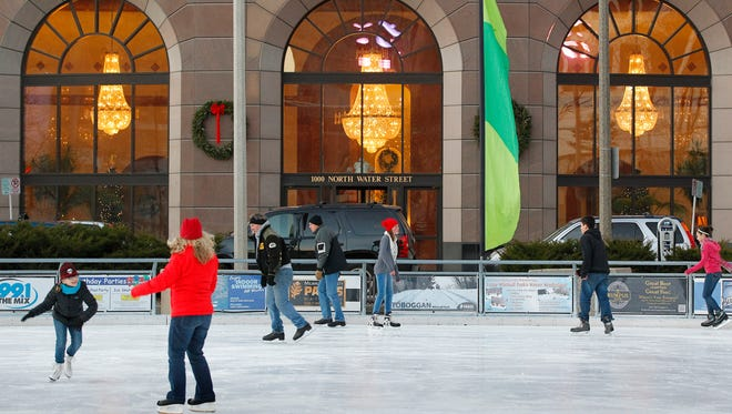 Skaters enjoy the ice at Red Arrow Park's Slice of Ice Rink.