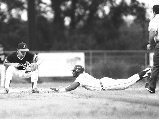 Florida State's Deion Sanders dives into second base against Louisville in the 1987 Metro Conference baseball tournament   (File Photo/The State)