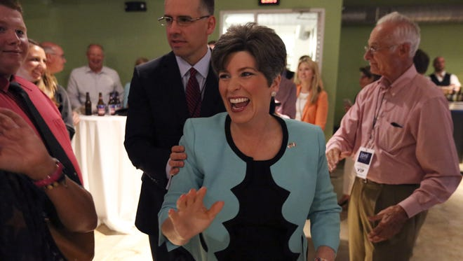 Joni Ernst celebrates her victory in the Republican Senate primary on Tuesday at the Des Moines Social Club.