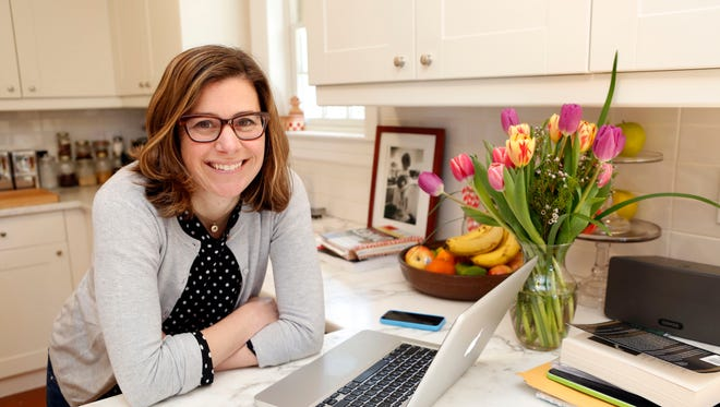 Jenny Rosenstrach, who writes a cooking blog with her husband, is photographed April 3, 2014 in her Dobbs Ferry home. Rosenstrach has a new cook book coming out soon.