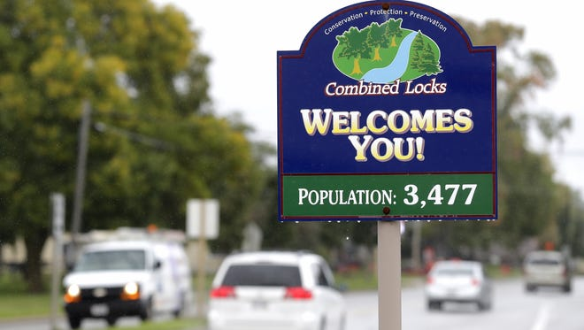 The village of Combined Locks is researching ways to reduce its costs for police services.