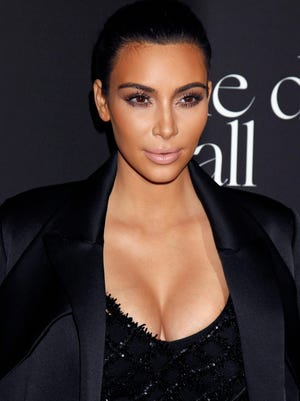 epa04526012 US Actress Kim Kardashian arrives for the Rihanna's first annual Diamond Ball at The Vineyard in Beverly Hills, California, USA, 11 December 2014. Robyn 'Rihanna' Fenty founded the Clara Lionel Foundation (CLF) in 2012, in honor of her grandparents, Clara and Lionel Brathwaite. CLF's grants fund efforts promote health, education, arts and culture globally.  EPA/JIMMY MORRIS ORG XMIT: JMX19