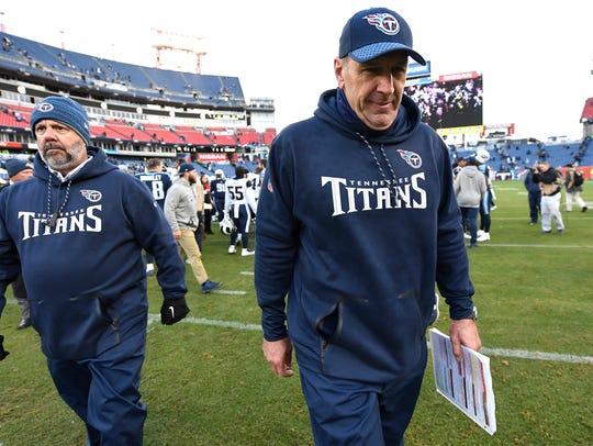 Titans head coach Mike Mularkey walks off the field