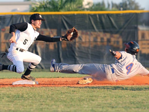 Mariner's Brandon Feehery attempts to tag Cape Coral's Robert Becker as he slides safely into second base on Tuesday night during the Region 5A-3 semifinal.
