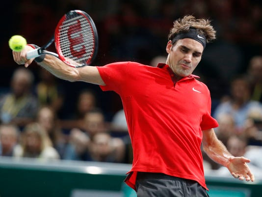 Roger Federer of Switzerland returns the ball to Jeremy Chardy of France during their second round match at the ATP World Tour Masters tennis tournament at Bercy stadium in Paris, France, Wednesday, Oct. 29, 2014. 2(AP Photo/Michel Euler)