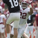 Alabama linebacker Ryan Anderson (22) pressures quarterback Cooper Bateman (18) during the Alabama A-Day spring football game at Bryant Denny Stadium in Tuscaloosa, Ala., on Saturday April 16, 2016.