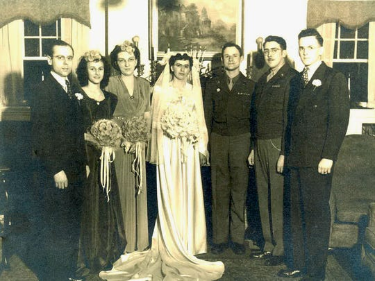 """Helen Powell, center, at her marriage to Richard """"Dick"""" Powell."""