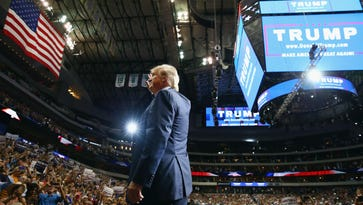 Donald Trump waves to the audience during a campaign rally at the American Airlines Center on Sept. 14, 2015, in Dallas.