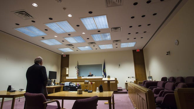 Attorney Norm Blais appears before Judge Helen Toor in the matter of a lawsuit against Burlington College in Vermont Superior Court in Burlington on Monday, February 22, 2016.
