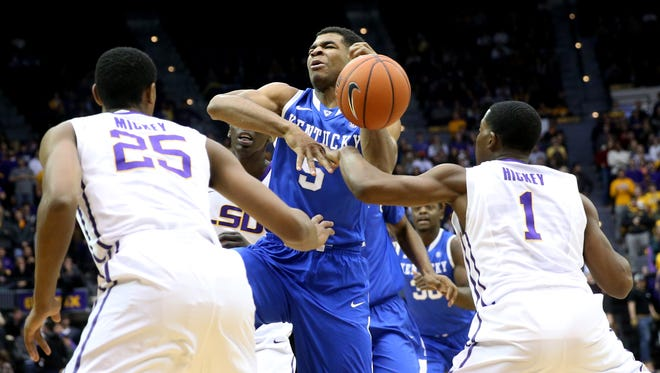 Jan 28, 2014; Baton Rouge, LA, USA; LSU Tigers guard Anthony Hickey (1) knocks the ball out of the hands of Kentucky Wildcats guard Andrew Harrison (5) in the first half at the Pete Maravich Assembly Center. Mandatory Credit: Crystal LoGiudice-USA TODAY Sports