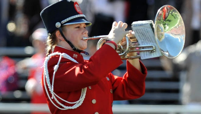 """As the Pride of the South Marching Band performes """"From Dixie With Love"""" the Ole Miss student section cheers along by saying """"the South will rise again"""" in this 2009 photo."""