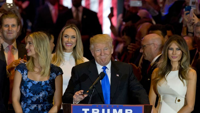 Republican presidential candidate Donald Trump is joined by his wife Melania, right, and daughter Ivanka, left, as he arrives for a primary night news conference, Tuesday, in New York.