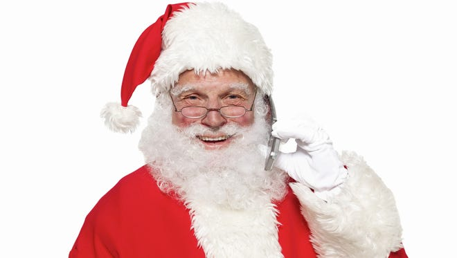 Portrait of Santa clause holding a mobile phone