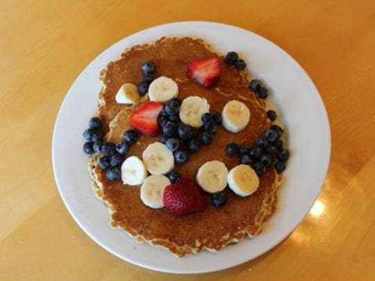 Multi-grain pancakes with fresh fruit served at Carver's in Denville.