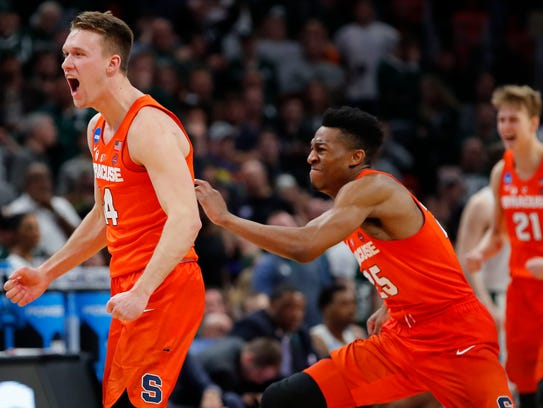 Syracuse's Braedon Bayer celebrates after the team beat Michigan State in the NCAA tournament.