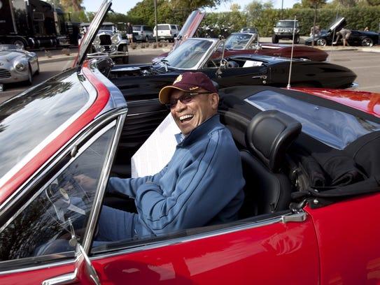 Baseball legend Reggie Jackson sitting in a 1973 Ferrari