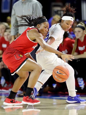 Louisville guard Taylor Johnson, left, knocks the ball away from MTSU  guard Ty Petty, right, in the first half on Nov. 16, 2016, in Murfreesboro,