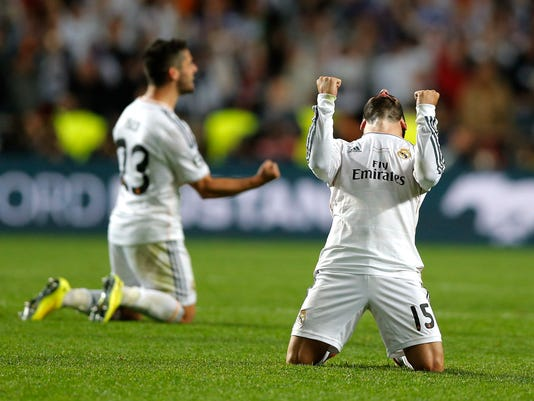 Real's Daniel Carvajal, right gestures, at the end of the Champions League final soccer match between Atletico de Madrid and Real Madrid, at the Luz stadium, in Lisbon, Portugal, Saturday, May 24, 2014. Real Madrid won 4-1. (AP Photo/Daniel Ochoa de Olza)