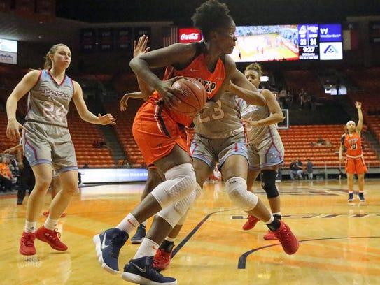 UTEP's Tamara Seda drives under the basket against