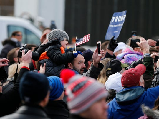 About 100 people greeted President Donald Trump and first lady Melania Trump at Lunken Airport on Monday, Feb. 5, 2018. The president's visit is part of a national campaign to convince skeptical Americans the GOP tax law is good for them.
